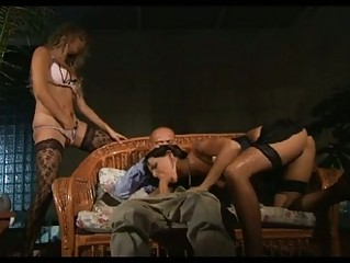 Two bitches in sluty lingerie sharing on cock in threesome
