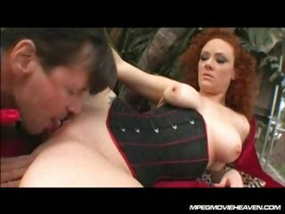 Redhead in corset gets licked