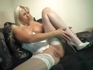 Girl in satin corset puts shoe in her pussy