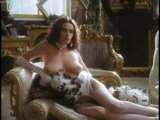 Naturally Busty Debra Beatty Shows Her Jugs and Bush In White Lingerie