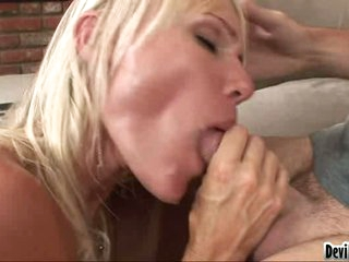 Daring blondie is pleasing her lover's stiff cock in her awesome mouth