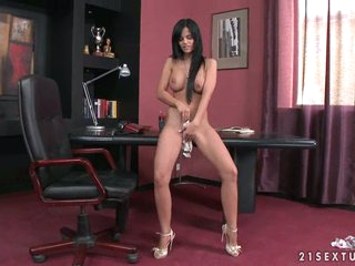 Sluty bombshell Black Angelica getting nude to a solo action