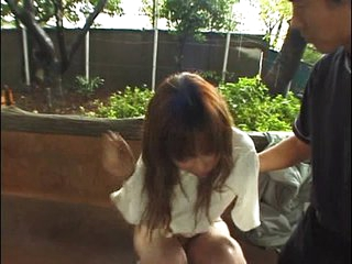 Leashed Asian peeing chick