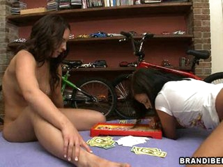 Brandi Belle and a friend play with a lucky guy's cock until it explodes