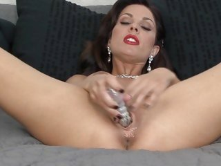 Alluring Jadra Holly plays with her wet pantie pot