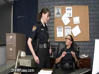Policewomen Interrogating In The Office