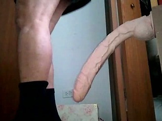 Guy in dress takes huge dildo in ass
