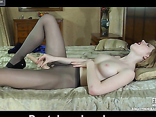 Ethereal golden-haired jamming a huge toy thru her barely black crotchless tights