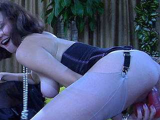 Wanton sweetheart strips to her corset and nylons to test the biggest sex toys