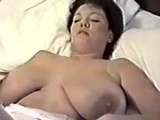 This homemade movie is a mix of hot vids I have taken of my huge-titted wife. You can see her strip, give me blowjob, shave her cunt, masturbate while I fuck her, play with sex toys and take a bath.