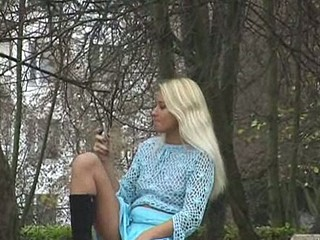 Slutty blonde was so busy talking on the phone outdoors that she didn't notice when she spread her legs demonstrating her pussy and then rubbed her booty and she didn't see the crazy spy hastily filming her!