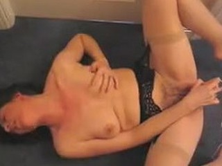 Mature lady gets on the floor and spreads her legs wide to feel the intense pleasure of a vibrator. The toy goes crazy on her pussy and she moans her way to an epic orgasm! Wicked loud masturbation is a must see!