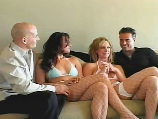 Two horny girls get naked to eat up and fuck these two older guys
