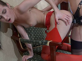 Red-stockinged lezzie worships nyloned legs previous to getting strap-on fucked