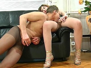 Horny guy fitting on grey hose for a kinky intercourse with a sexy playgirl
