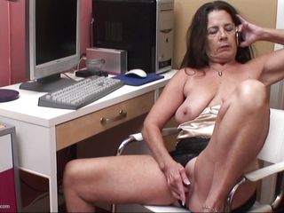Tia R. is rubbing and fingering her pussy, talking to her stud on the phone. She aches for his big, hard cock to be in her mouth and wet, hot hole. She wants him to know just how bad she wants it as she puts the phone down so he can hear the squishy sounds as her fingers work her shaven snatch.