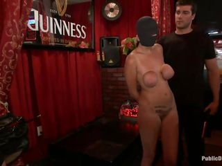 A sexy brunette starts the fun by bringing this whore in the pub, she's naked and doesn't has a clue about what will happen. Soon she founds out as two guys are holding her legs spread wide and a man fucks her shaved pussy deep and hard. She is getting fucked in the middle of the pub, what a dirty slut.
