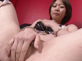 Japanese milf Rio Kagawa is horny and wants to pleasure her self with her toy. She takes off her bra and rubs her nipples while inserting her vibrating dildo deep inside her pussy. She stimulates her clit with the vibrator, too.