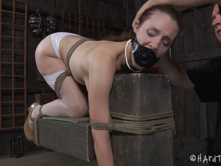 Iona Grace has a beautiful body and how the executor tied her in that position is just wonderful. The sweet milf stays there with a device that keeps her mouth opened but doesn't gags it so she can get fingered in that sexy mouth and with her ass up. A metal hook is in inserted in her anus and then she's dildo fucked