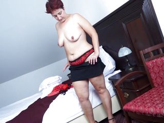Now that her sons are away in college, this bored single mom found herself helping herself in pleasing her body in her bedroom. She removes her bra and slowly touched her bare breasts and imagined that a man is is fingering her shaved pussy at the same time. She deserved to feel sexy and loved too!