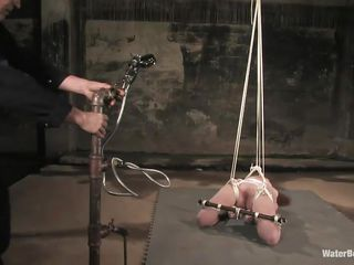 Sabrina Fox is in quite the predicament! She's face-up with her arms tied behind and under her and her legs the same. She gets a sprayer right on her pussy and a hand-held spray with a smaller, more concentrated jet. She moans, squeals and wiggles before being pulled up by the attached ropes.