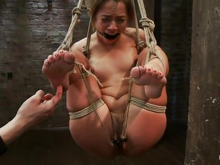 She's an innocent Rose but the mistress wants to play with her so she inserts those objects in her vagina, special made for punishing cute pussy's just like her's. She screams with pain when the mistress starts fucking her tight anus with a big dildo, look at her hanging all tied up and getting fucked in the ass.