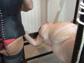 Some heavy duty ropes are used to tie this fat old granny and a solid metal frame. Vera is a huge slut with enormous boobs and a passion for being dominated. Her mistress give Vera what she wants more, some punishment. She uses clothespins to keep her pink wet pussy gaped and from now on things get's rough