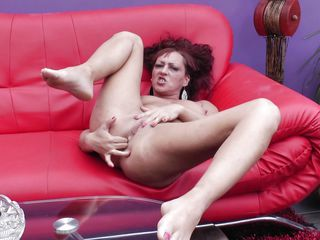 Pamela is a lustful bitch that never has enough. When she masturbates she does it like a sex maniac! This time the horny redhead mature fingers both her anus and vagina in the same time. She likes when she has her holes stuffed and only a big hard cock or dildo in her mouth will make the bitch happier