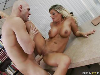 This blonde with big tits is being fucked on the table by a big male. He is penetrating her very hard and is licking her boobs. The slut is very horny and now the guy is fucking her from her back with his big cock. Surely they will have a nice orgasm because they do a fantastic sex scene.