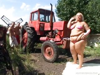 Melinda is so much woman she needs two men to fuck her. Tibor and Gabor lift up her fat folds and spread her ass cheeks. The both suck on her huge melons outside by the tractor. The rubs every part of her big fat beautiful body.