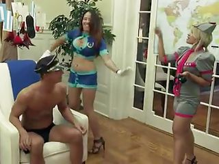 These naughty milfs invite two boys for an orgy at their home. First they ask the guys to take off their clothes and play games with them. After that brunettes give them lap dance and kiss them and give them the feel of their pussy.
