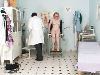 Look at this mature slut Mora with big ass. She is at her doctor's chamber and about to get her pussy examined. After undressing she is being told to sit on the doctor's table and to spread her legs. Right after that the doctor is gaping her pussy he is using a light to see whats the condition inside.