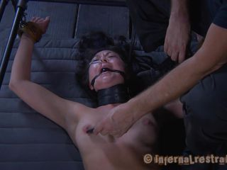 Nyssa is a brunette milf with a very low self esteem. She is tied with her legs spread and the executor punishes and humiliates her the best he can. Look how he steps on her and then plays with that shaved cunt. Nyssa will surely receive more punishment as the session just began.