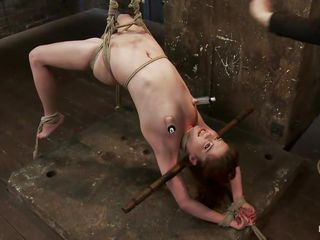 Wee all enjoy seeing a cute bitch getting what she deserves but this one receives a harsh treatment, her sexy oiled body is tied up and she's hanging while her executor uses a vibrator on her sweet cunt, fingering her pussy in the mean time. Her hot tits have suckers on them and her legs are spread granting full access to her cunt. What will happen to her next? Want to see?