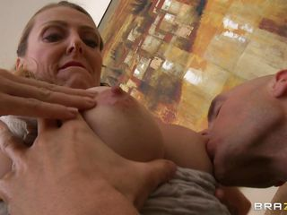 Brenda James has a cock in her hand and a man's mouth on her tits, licking and sucking, and even a motorboat. She rubs her pussy juice on her nipples to have it sucked off, and keeps rubbing her cunt. She finally gets her top all the way down, getting ready to be fucked on the couch.