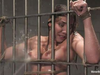 After he tied her on the bars and gave her body a good showering the executor thinks that it's time for a bath so he handcuffed her and putted her sexy body completely under water allowing her to breath only through a tube. She 's tied and the man has complete control over her so why not finger her cunt too.