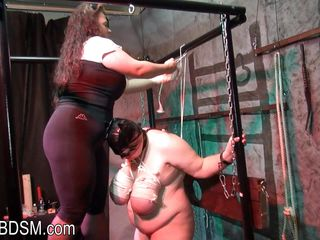 Really fat bitch is all tied up with strings, even her titties are going to burst into flames any minute now. Rebeca, her executor, enjoys watching her with a catwoman mask and squeezed tits. The fat slut lies down and spread her legs because her pussy is very happy being fingered so hard and becomes wet!
