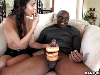Brunette woman, with a box full of doughnuts is playing with a black man's cock. She puts some doughnuts over his dick, making it sweeter, then she begins to suck his dick. Then she has her pussy licked.