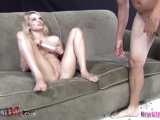 This blonde slut with sexy body and perfect tits is sitting on the sofa and is playing with her vagina. The bitch has a giant dildo and she penetrates her tight pussy with it very deep. A guy appears and starts licking this blonde vagina and clitoris and after that maybe they will fuck very hard.