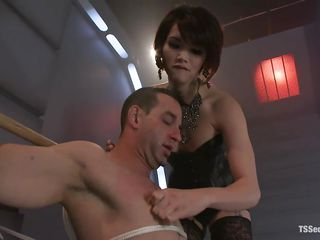 Eva likes to be the boss when it's about fucking, she's humiliating this hot man by torturing his dick with her high heels and then whips him. Her dick stuffs his mouth after that punishment and she suffocate him. Her cock fills his mouth and goes in his throat, do you think he likes it that way? Who cares, he is her slut and will obey!