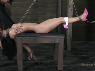 Wenona is one sexy honey, even sexier when she's all tied up and put in pain and humiliation! She's bound and gagged with a cock, made to take it all the way down her throat. After her face gets fucked nicely, her captor presses a vibrator against her cunt while he fucks her face again. What's next?