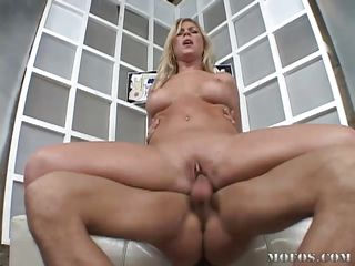 Trampy blonde Rhiannon Alize get's her tight pussy filled by his big dick. She enjoys every inch of penis she can get and rubs her cunt while fucking. Look at her tight vagina between those spread legs, is he going to cum in her?