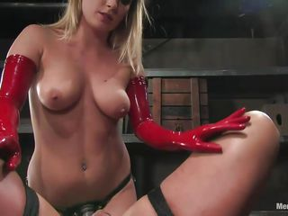 The dominant blonde babe wearing nothing but high heels and a pair of red latex gloves fists this guy's anus with intense pleasure. He is ball gagged and has nothing to say as the blonde goes deeper and deeper in his anus, sometimes with both her hands! She decides to give his ass a break and starts by sucking his cock.