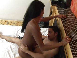 Luciana Foxx is getting her juicy ass fucked by that shemale loving guy. Se him fucking Foxx's tight ass wearing a condom. And as she's riding his cock, she is moaning with pleasure! The guy sucks her nipples while she's in cowgirl. And when she's riding in reverse, she jerks her cock and finally both of them cum together!
