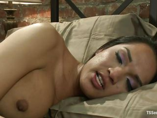 Jessica was lazying in her bed when her boy Rod arrived. She got turned on immediately by his superb butt and started fucking him from behind. Jessica's hard cock penetrated his tight, shaved anus. She then gave him a lustful rimjob before continuing the ass fucking. Is the brunette shemale going to cum in that ass