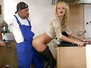 Skinny blonde gets banged doggy style by tattooed stud in kitchen