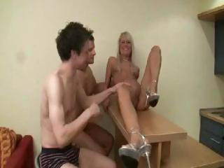 Two guys fist-fuck a German blondie before putting their cocks in her holes