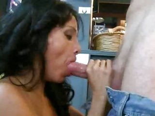 Luscious milf shoves a huge dick down her throat