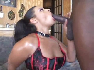 Black girl dolled up in lingerie sucks black cock