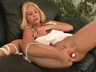 Happy blonde squirts during her toy play